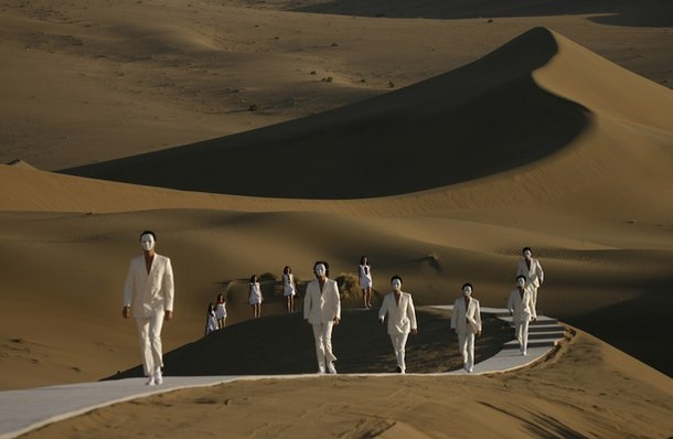 Models parade on a catwalk in the desert of Whistling Sand Mountain on the outskirts of Dunhuang in China's northwest Gansu province for iconic French fashion designer Pierre Cardin, 20 October 2007. Cardin launched his spring-summer 2008 collection in the desert of Whistling Sand Mountain on the edge of the Silk Road, almost 30 years after he first launched a collection in China. AFP PHOTO/Peter PARKS (Photo credit should read PETER PARKS/AFP/Getty Images)
