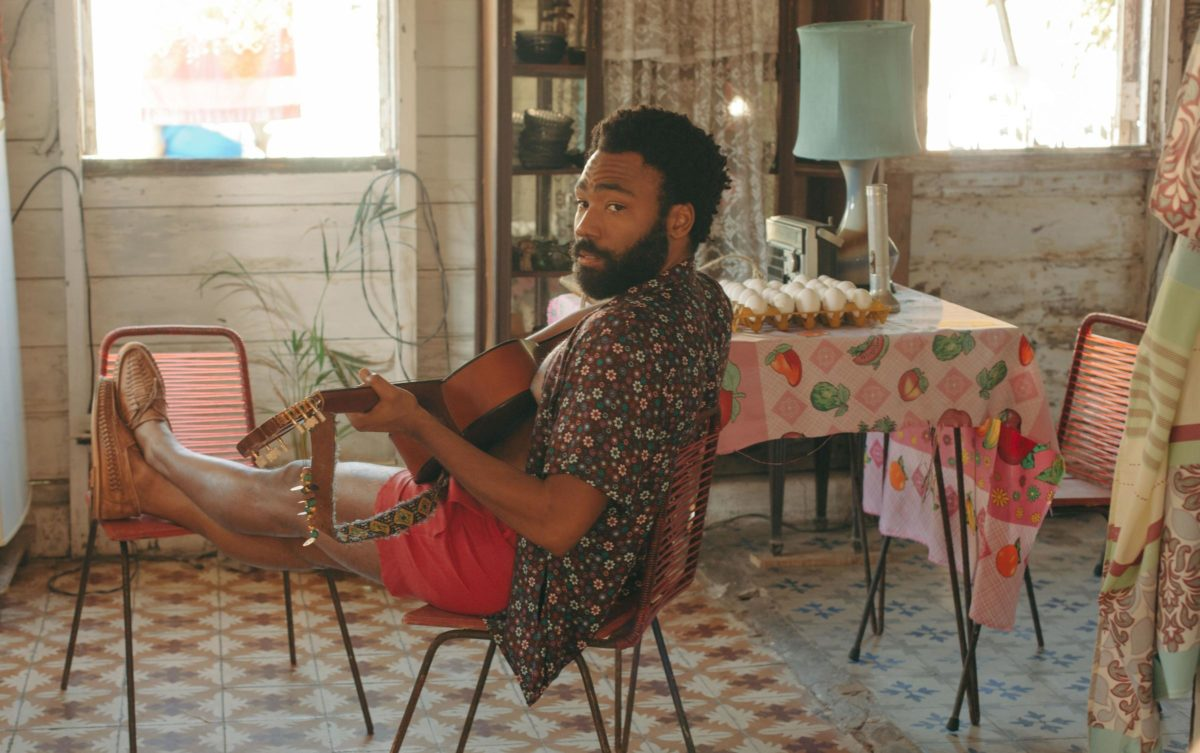 Donald Glover in a still from Guava Island , which he stars in with Rihanna. The film premiered at Coachella, where Glover's musical act Childish Gambino headlined on Friday.